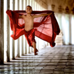 Young buddhist monk jumping